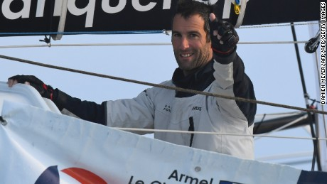 French skipper Armel Le Cleac'h celebrates as he sails his Imoca monohull upon his arrival at the finish line of the Vendee Globe solo around the world sailing race, on January 19, 2017 off Les Sables d'Olonne, western France. French skipper Armel Le Cleac'h won the Vendee Globe solo round the world yacht race on January 19, 2017 in a record time. / AFP / Damien MEYER        (Photo credit should read DAMIEN MEYER/AFP/Getty Images)
