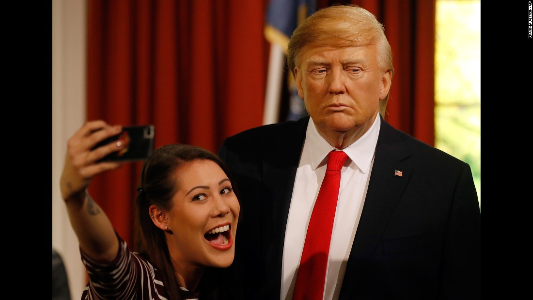 "A Madame Tussauds employee takes a selfie next to a wax figure of US President-elect Donald Trump in London on Wednesday, January 18. A team at Madame Tussauds <a href=""http://www.cnn.com/2017/01/18/politics/trump-waxwork-madame-tussauds/"" target=""_blank"">spent five months preparing the wax figure</a> of the soon-to-be president, and unveiled it just days ahead of Trump's presidential inauguration."