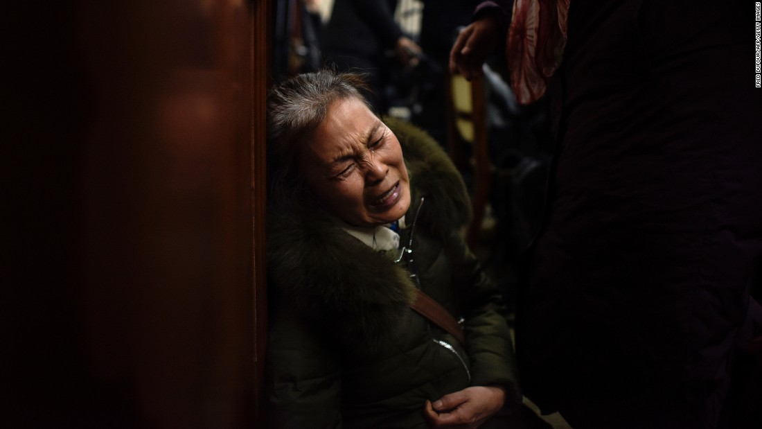 "A relative of passengers aboard missing Malaysia Airlines Flight 370 cries before a meeting in Beijing on Wednesday, January 18, a day after authorities announced <a href=""http://www.cnn.com/2017/01/17/asia/mh370-search-suspended/index.html"" target=""_blank"">the end of search operations for the aircraft</a>. The plane, which vanished en route from Kuala Lumpur to Beijing on March 8, 2014, had 239 people on board."