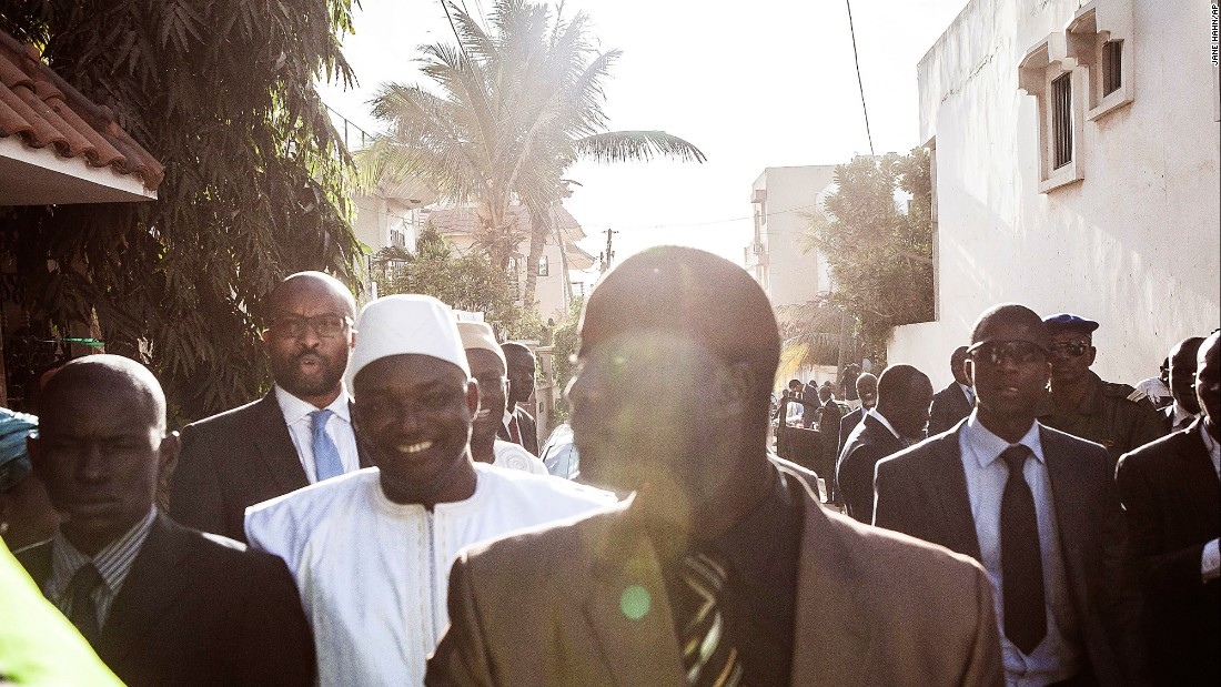 "Adama Barrow, in white, leaves the Gambian Embassy after being inaugurated in Dakar, Senegal, on Thursday, January 19. Barrow was <a href=""http://www.cnn.com/2017/01/18/africa/gambia-jammeh-barrow/index.html"" target=""_blank"">sworn in Thursday as Gambia's new President</a> at the West African nation's embassy in neighboring Senegal. Incumbent Gambian President Yahya Jammeh has refused to step down, and Senegalese troops have since entered Gambian territory in a bid to resolve the standoff, according to the state-run APS news agency."