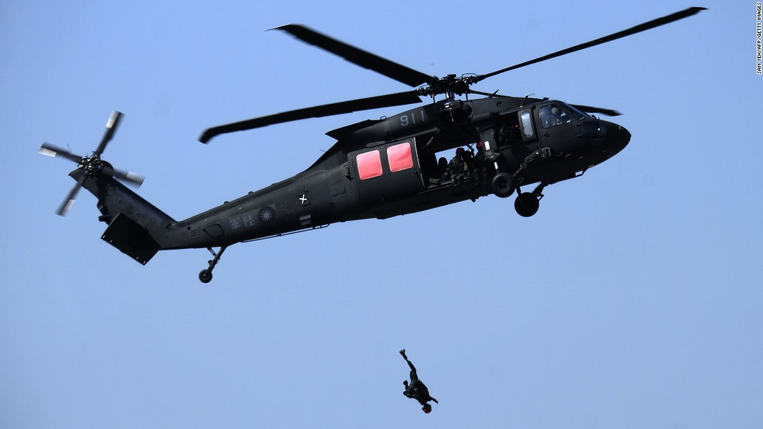 A mannequin is thrown from a Black Hawk helicopter during an annual military drill in Taichung, Taiwan, on Tuesday, January 17.