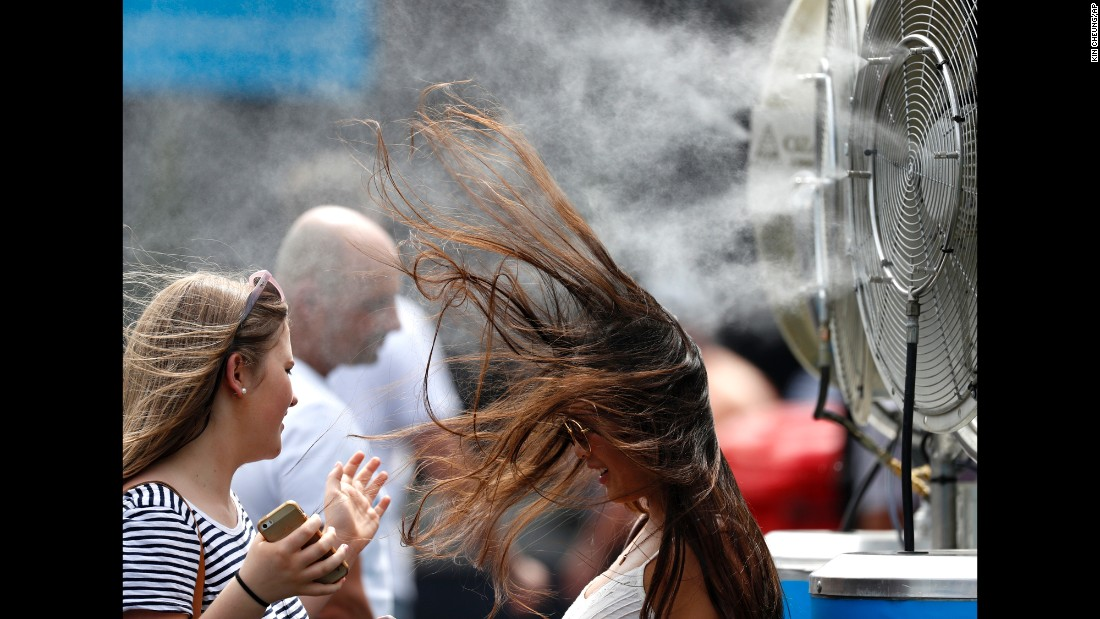 A spectator cools off at the Australian Open tennis championships in Melbourne on Tuesday, January 17.