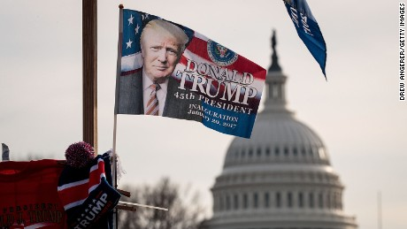 With the U.S. Capitol in the background, a 'Trump' flag flies on top of a merchandise stand on North Capitol Street, January 19, 2017 in Washington. DC.