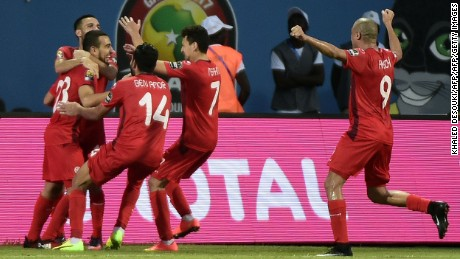 Tunisia's midfielder Naim Sliti (L) celebrates with teammates after scoring a goal during the 2017 Africa Cup of Nations group B football match between Algeria and Tunisia in Franceville on January 19, 2017. / AFP / KHALED DESOUKI        (Photo credit should read KHALED DESOUKI/AFP/Getty Images)