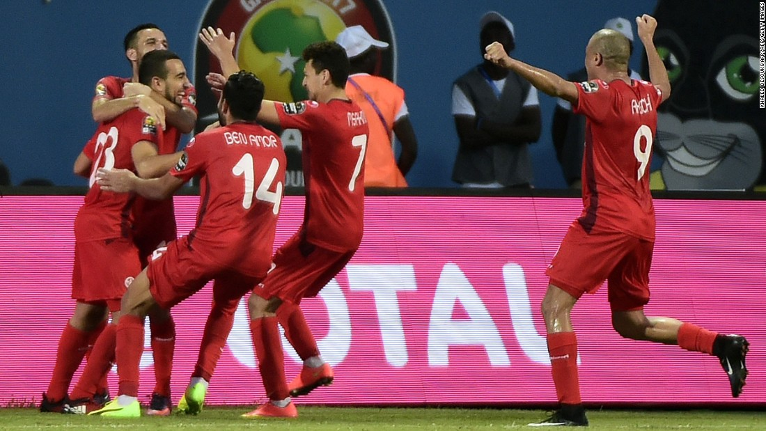 Tunisia's players celebrate after Naïm Sliti's penalty put his side 2-0 up in a crucial Group B clash against Algeria.