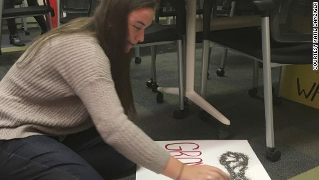 Jilly Horowitz prepares signs for Saturday's Women's March on Washington.