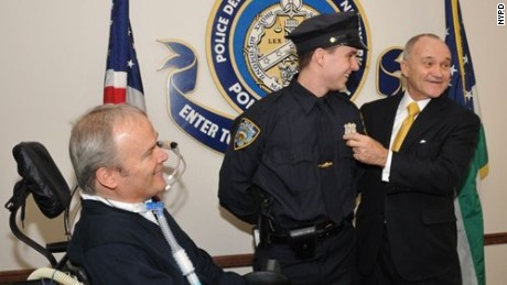 Detective Steven McDonald joined his son Conor as he received his police officer shield.