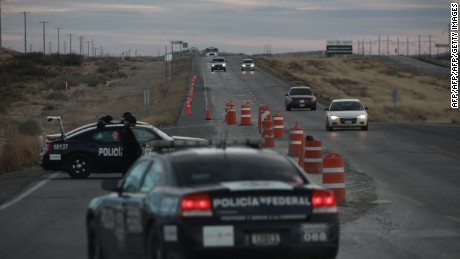 """Federal Police patrols park outside of Federal Prison Cefereso number 9 where Joaquin Guzman Loera aka """"El Chapo Guzman"""" was jailed before being extradited to the United States in Ciudad Juarez, Mexico on January 19, 2017.  Mexico extradited drug kingpin Joaquin """"El Chapo"""" Guzman to the United States -- handing over one of the world's most notorious criminals on the eve of US President-elect Donald Trump's inauguration. / AFP / HERIKA MARTINEZ        (Photo credit should read HERIKA MARTINEZ/AFP/Getty Images)"""