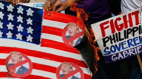 Protesters burn a mock US flag during a rally outside the US Embassy in Manila on Friday.
