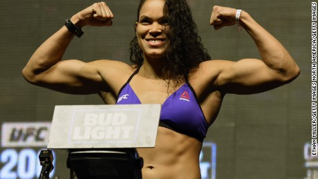 LAS VEGAS, NV - JULY 08:  Mixed martial artist Amanda Nunes poses on the scale during her weigh-in for UFC 200 at T-Mobile Arena on July 8, 2016 in Las Vegas, Nevada.
