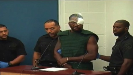Man accused of shooting cop curses at judge