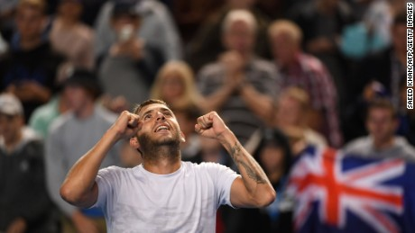 Britain's Daniel Evans celebrates his victory against Australia's Bernard Tomic.