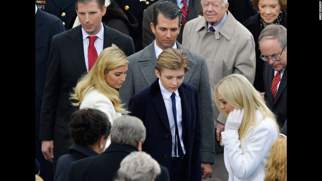 Trump's children look for their seats before the ceremony begins.