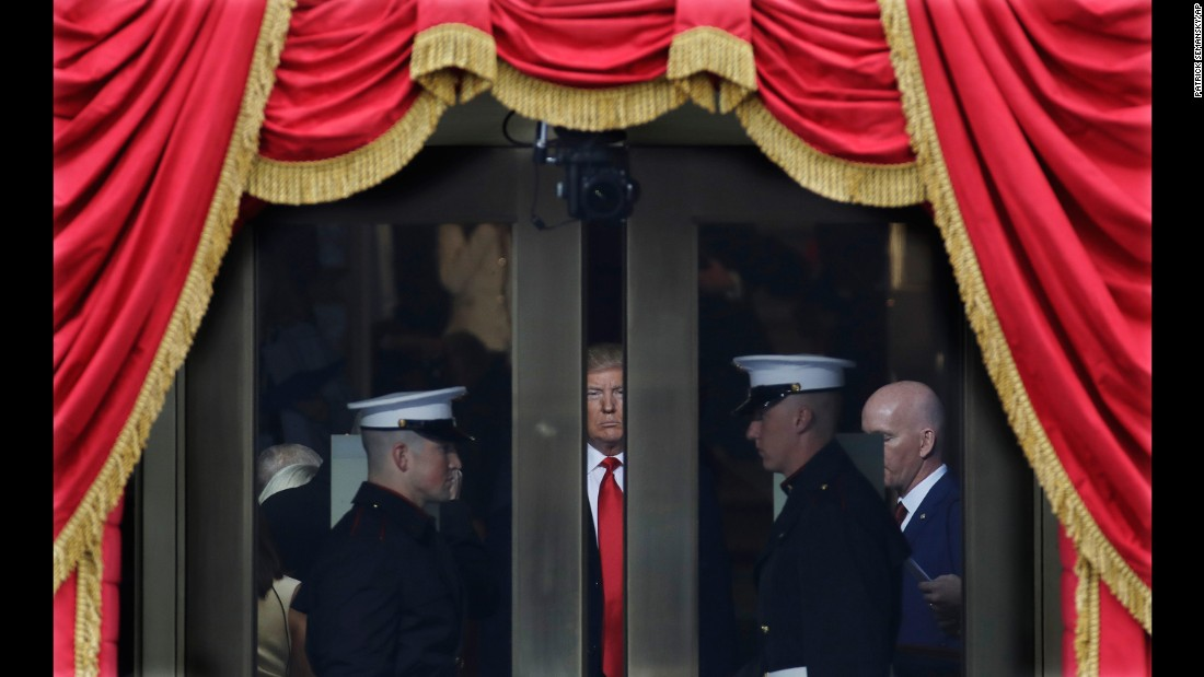 Trump waits to step out onto the portico for his presidential inauguration.