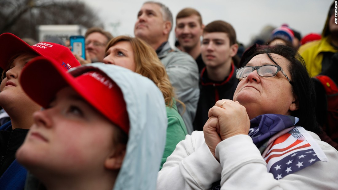 Supporters watch as Trump appears for his inauguration.