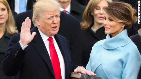 Donald Trump is sworn in as the 45th President of the United States as his wife Melania looks on on Friday, January 20.