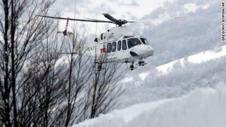 A rescue helicopter approaches the area in Rigopiano, central Italy, where a hotel have been buried under an avalanche on Wednesday, to recover 6 people who have been reportedly extracted alive from the debris, Friday, Jan. 20, 2017. (AP Photo Gregorio Borgia)