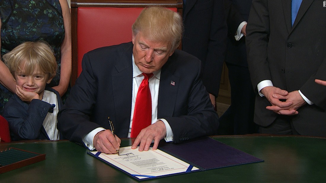 President Donald Trump signs first bill into law