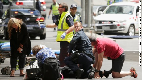 MELBOURNE, AUSTRALIA - JANUARY 20:  Members of the public are given mediacal treatment on January 20, 2017 in Melbourne, Australia. Three people have been killed and 20 are injured after a man deliberately drove his car into pedestrians in Bourke Street Mall on Friday.  (Photo by Darrian Traynor/Getty Images)