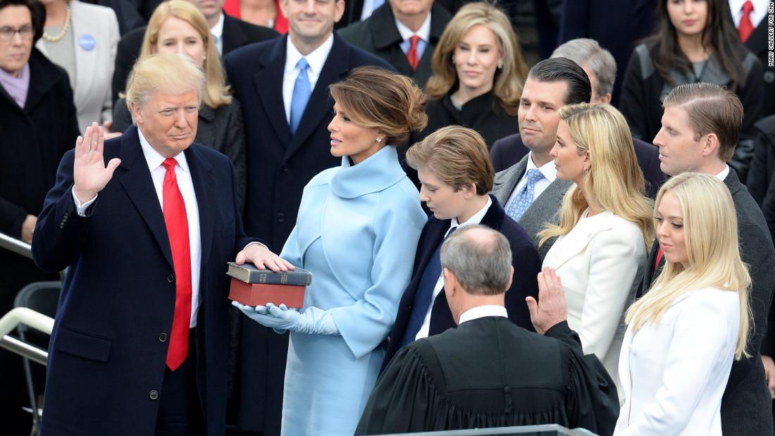 Trump is joined by his family as he is sworn in as President on January 20.