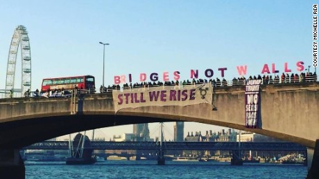 "Protesters hold letters spelling out ""Bridges Not Walls"" on London's Waterloo Bridge on Friday morning."