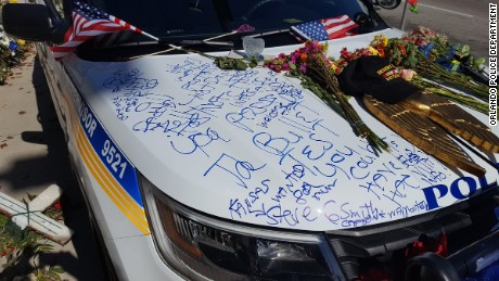 Just one day after her alleged killer appeared in court, Lt. Debra Clayton's squad car was defaced as it sat outside the Orlando Police Department headquarters in memoriam.