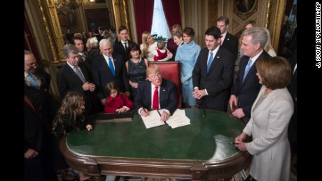 President Donald Trump is joined by the Congressional leadership and his family as he formally signs his cabinet nominations into law, in the President's Room of the Senate, at the Capitol in Washington, Friday, Jan. 20, 2017. From left are Senate Minority Leader Chuck Schumer, D-N.Y., Sen. Roy Blunt, R-Mo., Donald Trump Jr., Vice President Mike Pence, Jared Kushner, Karen Pence, Ivanka Trump, Barron Trump, Melania Trump, Speaker of the House Paul Ryan, R-Wis., Majority Leader Kevin McCarthy, D-Calif., House Minority Leader Nancy Pelosi, D-Calif. (AP Photo/J. Scott Applewhite, Pool)