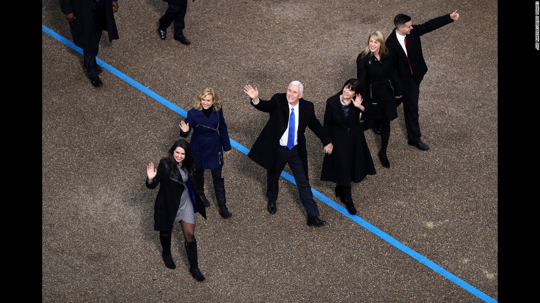 Vice President Mike Pence, center, waves to supporters as he walks with his family during the Presidential Inaugural Parade.