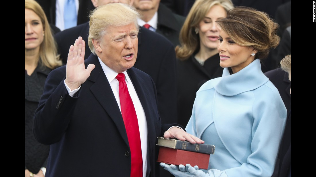 "Donald Trump is <a href=""http://www.cnn.com/2017/01/20/politics/donald-trump-inauguration-highlights/"" target=""_blank"">sworn in as the 45th President of the United States</a> as his wife, Melania, looks on during the inauguration ceremony in Washington on Friday, January 20. He used a family bible and one that belonged to Abraham Lincoln."