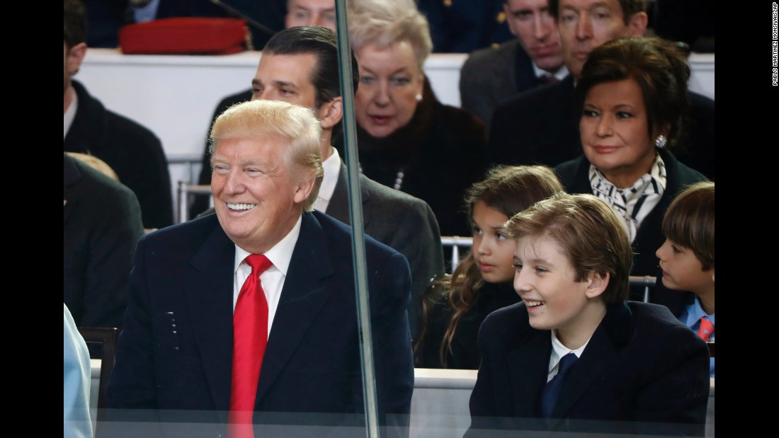 President Donald Trump smiles with his son Barron as they watch the 58th Presidential Inaugural Parade in Washington on Friday, January 20.