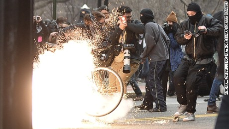 TOPSHOT - A police flash-bang grenade explodes as they clash with protesters after the inauguration of US President Donald Trump on January 20, 2017 in Washington, DC. / AFP / Andrew CABALLERO-REYNOLDS        (Photo credit should read ANDREW CABALLERO-REYNOLDS/AFP/Getty Images)