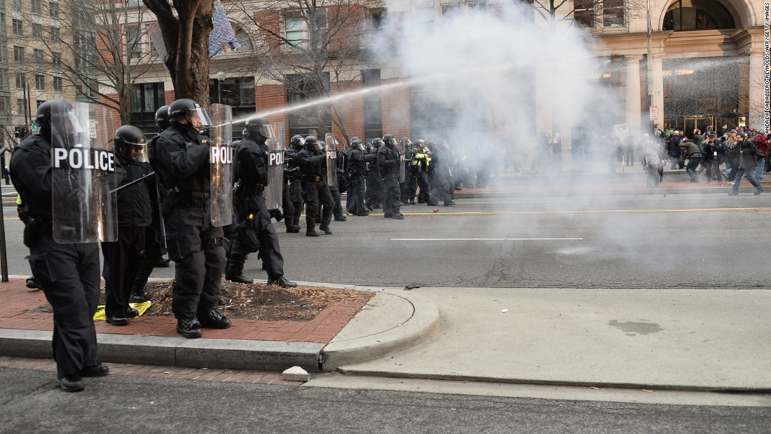 "Protesters clash with police. ""I think Donald Trump is a fascist, and it's very easy for people, especially people who are in pain, to slip into fascism,"" said protester Lysander Reid-Powell, a 20-year-old student from New Mexico."