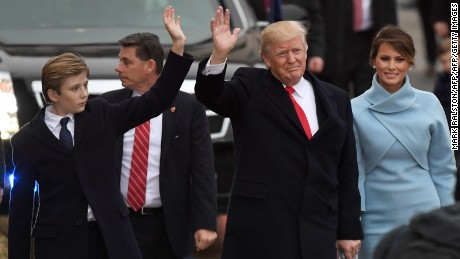 US President Donald Trump and First Lady Melania Trump and their son Baron walk the inaugural parade route on Pennsylvania Avenue in Washington, DC, on January 20, 2107 following swearing-in ceremonies on Capitol Hill earlier today. / AFP / Mark RALSTON        (Photo credit should read MARK RALSTON/AFP/Getty Images)