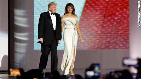 President Donald Trump, left, arrives with first lady Melania Trump at the Liberty Ball, Friday, Jan. 20, 2017, in Washington.