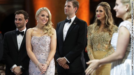 Tiffany Trump and her guest Ross Mechanic, and Eric Trump and his wife Lara Yunaska watch as US President Trump cuts a cake.