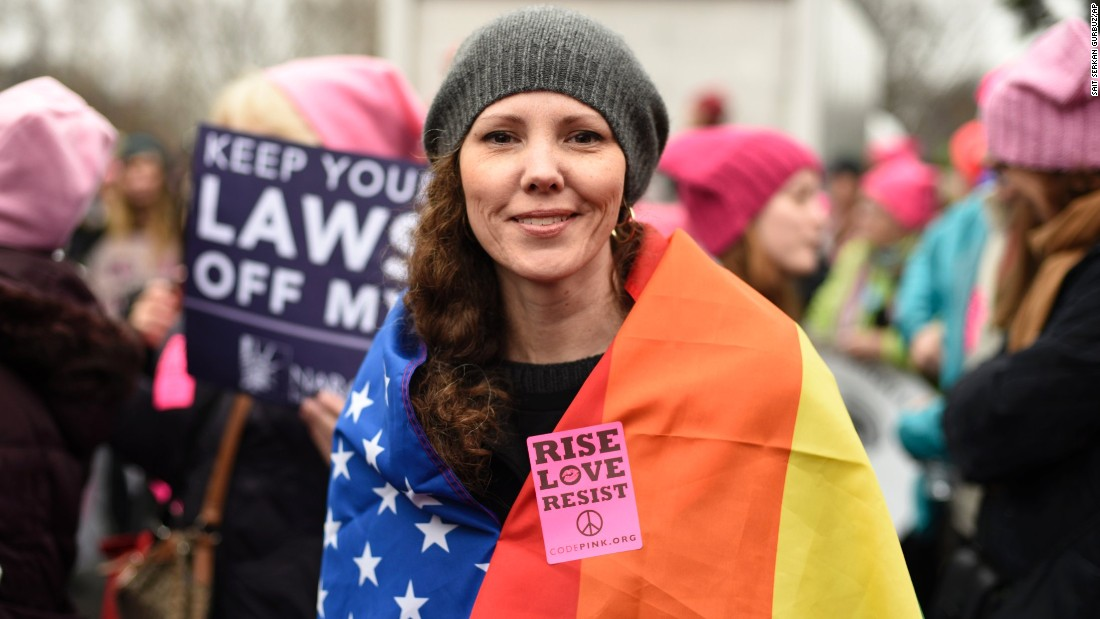 New Yorker Nicole Monceaux joins in the march.