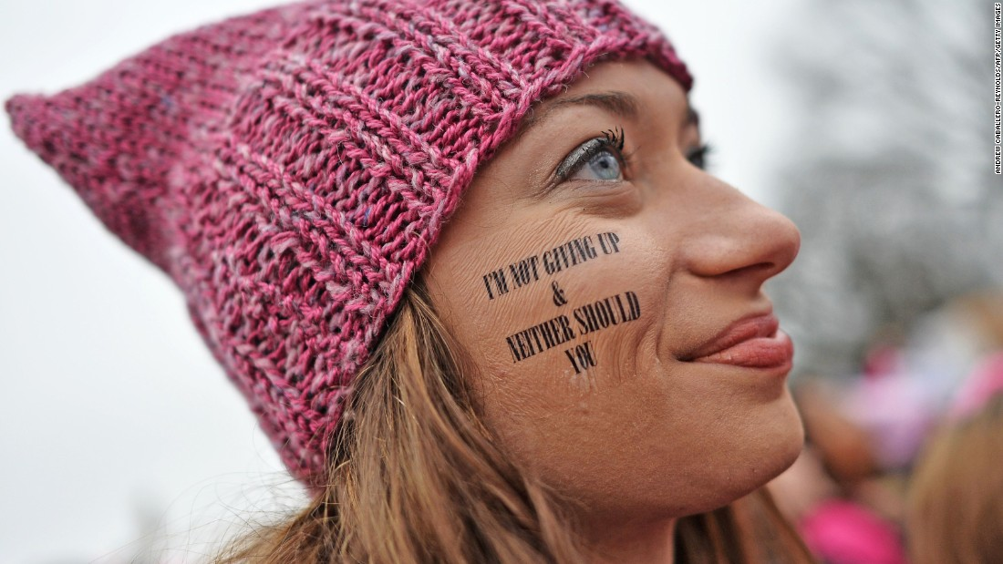 A woman wears a pink hat to send a message during the protest.