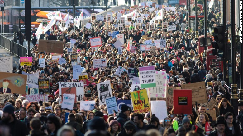 Protesters march from The US Embassy in Grosvenor Square towards Trafalgar Square during the Women's March on January 21, 2017 in London, England.