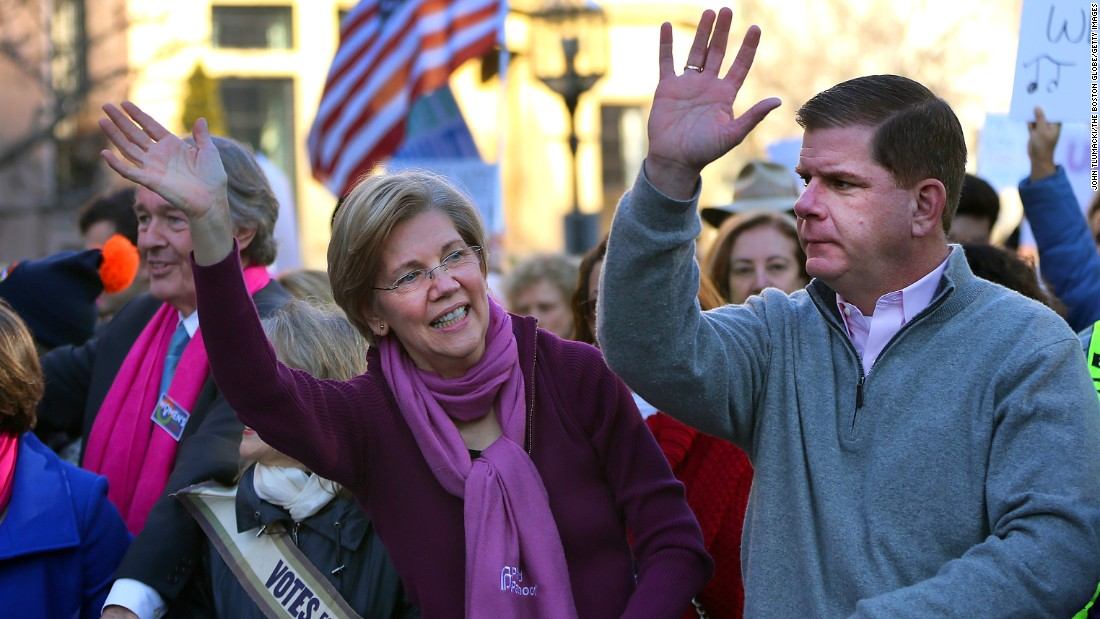 Thousands of people filled Boston Common for the Boston Women's March for America on Saturday, January 21, 2017. Sen. Elizabeth Warren and Boston Mayor Marty Walsh wave to the crowd as they march down Commonwealth Avenue.