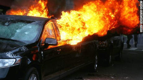 A limousine burns after being destroyed by anti-Trump protesters on K Street on January 20, 2017 in Washington, DC.