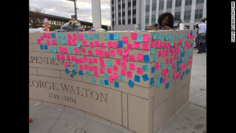 "The ""wall of solutions,"" covered in sticky notes."