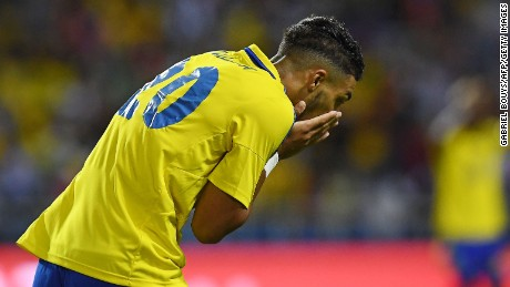 Gabon's forward Denis Bouanga reacts after missing an early chance against Cameroon.