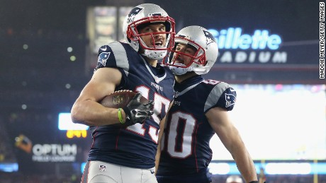 Hogan celebrating with Danny Amendola after scoring against the Pittsburgh Steelers in the AFC Championship Game.