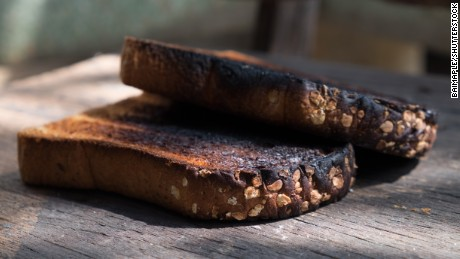Crispy and Crunchy Over Burned Toasts place outdoor on wooden stool in Daylight
