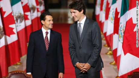 "Mexican President Enrique Pena Nieto(L) and Canadian Prime Minister Justin Trudeau arrive to speak with the media following bilateral meetings ahead of the ""Three Amigos Summit"" at Parliament Hill in Ottawa, June 28, 2016.      Canadian Prime Minister Justin Trudeau and his guests US President Barack Obama and Mexican President Enrique Pena Nieto will meet in Ottawa for the North American Leaders Summit June 29 morning under a climate of economic uncertainty following Britain's vote to leave the European Union. / AFP / Chris Roussakis        (Photo credit should read CHRIS ROUSSAKIS/AFP/Getty Images)"