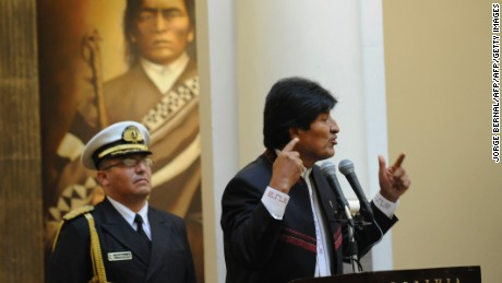 Bolivian President Evo Morales delivers a speech during the swearing-in ceremony of his new cabinet after appointing 10 new ministers and ratifying 10 others, at the Quemado presidential palace in La Paz, on January 23, 2017. Morales, who begins his twelfth year in power, announced a ministerial reform that will see the departure of his foreign minister David Choquehuanca and his main political operator in the presidency, Juan Ramon Quintana. / AFP / JORGE BERNAL        (Photo credit should read JORGE BERNAL/AFP/Getty Images)