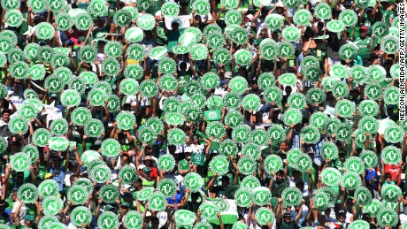 Chapecoense's supporters cheer before a friendly football match against Palmeiras -Brazilian Champion 2016- at the Arena Conda stadium in Chapeco, Santa Catarina state, in southern Brazil on January 21, 2017.  Most of the members of the Chapocoense football team perished in a November 28, 2016 plane crash in Colombia. / AFP / NELSON ALMEIDA        (Photo credit should read NELSON ALMEIDA/AFP/Getty Images)