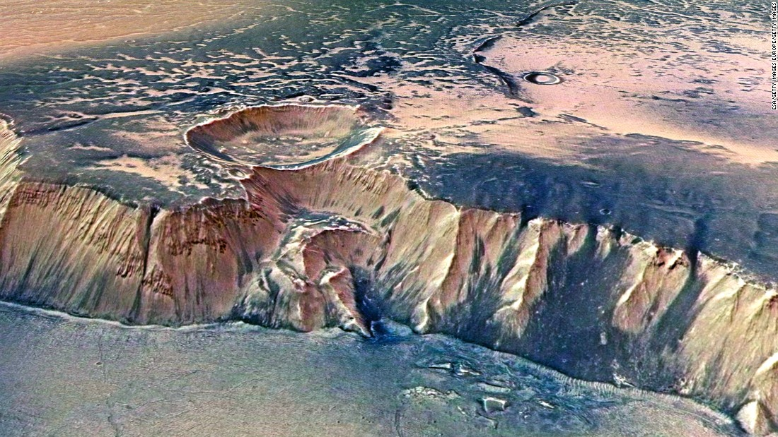 The Echus Chasma, one of the largest water source regions on Mars, as pictured from ESA's Mars Express. Scientists report that gigantic water falls may once have plunged over these cliffs on to the valley floor.