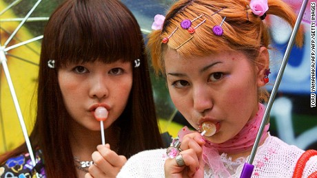 Japanese students hang out in Tokyo's popular fashion district.