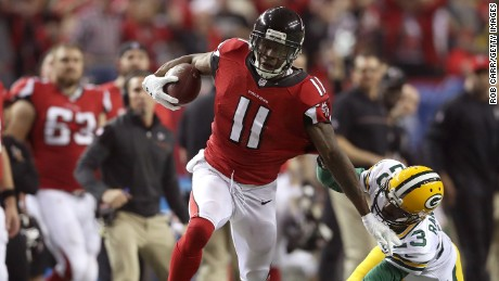 Julio Jones sprints after a catch for a 73-yard touchdown against the Green Bay Packers in the third quarter in the NFC Championship Game at the Georgia Dome on January 22 in Atlanta.